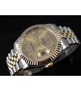 Rolex Oyster Perpetual  E706 Automatic 18K Gold-Gold Dial Diamond Markers-Stainless Steel Strap