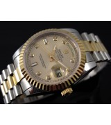 Rolex Oyster Perpetual E702 Automatic 18k Gold-Gold Dial Diamond Markers-Stainless Steel Strap