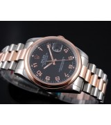 Rolex Oyster Perpetual E709 Automatic 18k Rose Gold-Black Dial Number Markers-Stainless Steel Strap