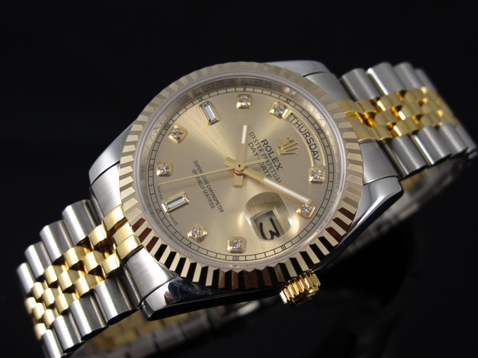 Rolex Oyster Perpetual E699 Automatic 18k Gold-Gold Dial Diamond Markers-Stainless Steel Strap