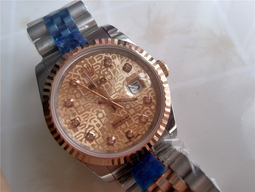 Rolex Oyster Perpetual E698 Automatic 18K Rose Gold-Rose Gold Dial Diamond Markers-Stainless Steel Strap